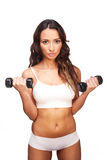 Sexy woman working out with dumbbells Royalty Free Stock Photos