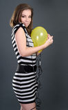 Sexy woman with yellow balloon Stock Image