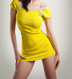 Woman in yellow short dress isolated on white background, studio shot. Attractive model in fashion concept. Girl in yellow short dress isolated on white stock photos