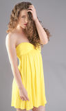 Sexy Woman in Yellow Strapless Dress Stock Image