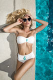 sexy woman young girl model in sunglasses and elegant white and black sexy swimsuit Royalty Free Stock Photos