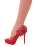 Sexy womanish leg in red shoe Stock Photography