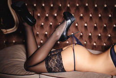 Sexy womans legs and ass in a black stockings Stock Image