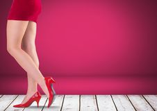 Sexy womans legs and red shoes with pink background. Digital composite of Sexy womans legs and red shoes with pink background Royalty Free Stock Image