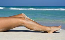 Sexy womans legs, tanning Royalty Free Stock Photos