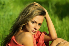 Sexy women. Sexy woman on green grass Stock Image