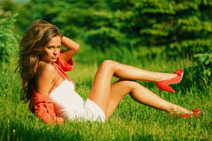 Sexy women. Sexy woman on green grass Stock Photography