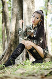 Sexy women in army clothes. Sexy woman in army clothes at the park Royalty Free Stock Image