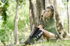 Sexy women in army clothes. Sexy woman in army clothes at the park Royalty Free Stock Photos