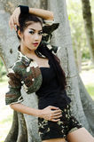 Sexy women in army clothes. Sexy woman in army clothes at the park Stock Photography