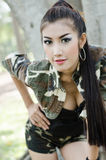 Sexy women in army clothes. Sexy woman in army clothes at the park Stock Photo