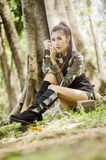 Sexy women in army clothes. Sexy woman in army clothes in the park Stock Images