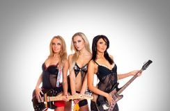 Sexy women as a music band Stock Photography