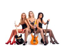Sexy women as a music band Royalty Free Stock Image