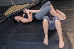 Sexy women fighting on floor Royalty Free Stock Photos