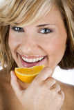 Sexy women holding fresh orange, promoting healthy lifestyle Royalty Free Stock Photography
