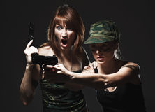 women holding gun Royalty Free Stock Image