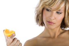 Women holding orange on white background. Woman holding fresh orange on white background Royalty Free Stock Images