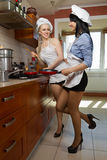 Sexy women in kitchen Stock Image