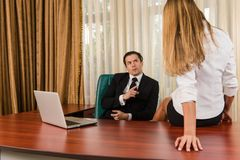 Conflict between boss and employee Stock Photography