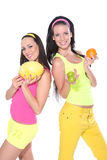 women posing with fruits on white background Stock Image