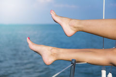 Sexy women's feet on the yacht Stock Images