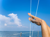 Sexy women's feet on the yacht Royalty Free Stock Image