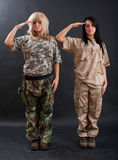 Sexy women saluting Stock Images