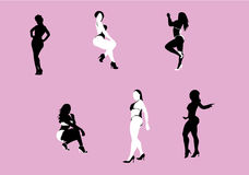 Sexy women silhouettes. Silhouettes of black and white women posing with sexy curves Royalty Free Stock Photos