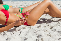Sexy women taking sun drinking cocktails. On the beach Royalty Free Stock Photo