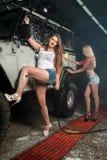 women washing car Stock Images