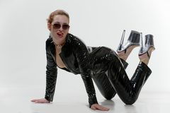 Sexy wouman in latex overalls in studio Royalty Free Stock Images