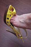 Sexy yellow shoe Stock Photography