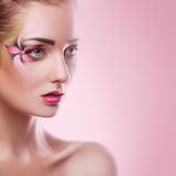 Sexy young adult female with flower make up on eye in studio Royalty Free Stock Photo