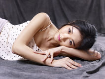 Sexy young asian model lying on floor Stock Photos