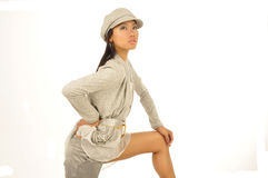 Sexy young Asian wearing a cap. Isolated photo on white background of a sexy young Asian woman with long hair and wearing a cap Stock Photo