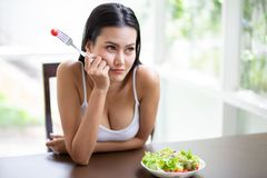 Sexy Young Asian Woman In White Singlet Boring Eating Fresh Organic Salad . A Beautiful Girl Have Breakfast Dislike Healthy Food Stock Photo