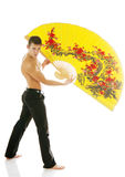 Sexy young athletic man with yellow fan Royalty Free Stock Photo