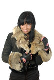 Sexy young babe in fur coat Stock Photos