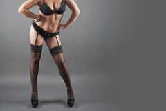 Sexy young bbw girl in black lingerie and stockings Stock Image