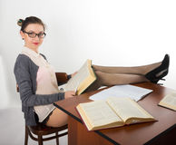Sexy young beautiful female teacher sitting at a Royalty Free Stock Photo