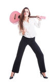 Sexy young and beautiful female or woman guitarist Stock Images