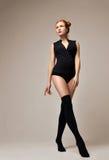 Sexy young beautiful full body woman posing in black modern biki Stock Photography