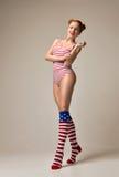 Sexy young beautiful full body woman posing in black modern biki Stock Image