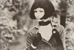 young beautiful pretty woman girl lady model with black bob hair hairdo vintage retro sepia old aged Royalty Free Stock Photos