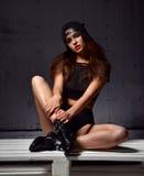 young beautiful woman posing in black modern bikini vest an Royalty Free Stock Photo