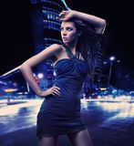 Sexy young beauty. Posing over night city background Royalty Free Stock Photo
