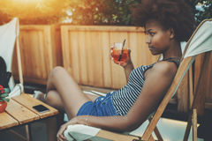 Sexy young black girl with glass of spritz Stock Photo
