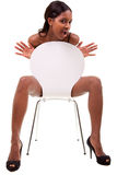 Sexy young black woman posing in chair Stock Photos