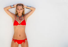 Sexy young blond fashionable woman in a red bikini Royalty Free Stock Images